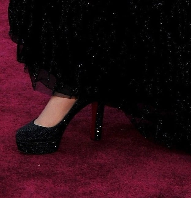 When Adele lifted her black embellished Jenny Packham gown, we got a shot of her sparkly black Christian Louboutin pumps.