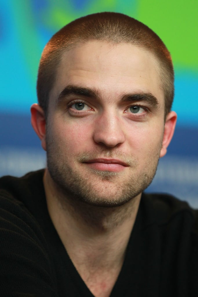 Rob looked handsome in his black V-neck tee.