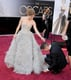 Darren Le Gallo helped Amy Adams with her dress as they made their way into the show.