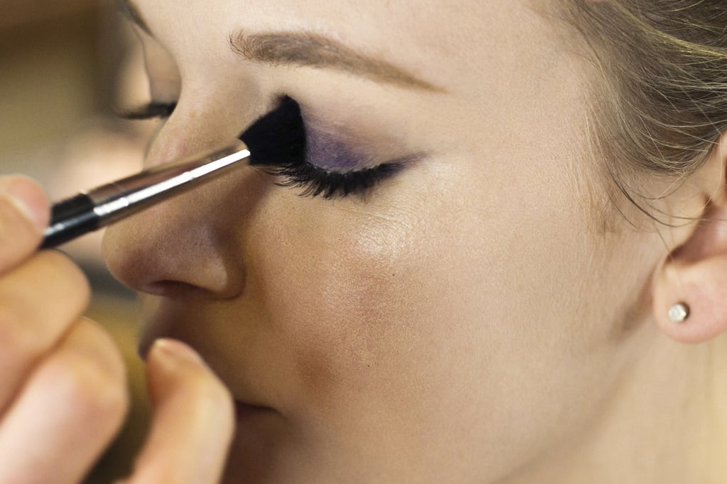 """Line the upper lash line with the same deep violet liner. """"I like to follow the contour of the eye shape instead making one straight line,"""" Jennings says. Start with a thin line at the inner corner of the eye and create a gradually thicker line as it reaches the outer corner.  Next, """"stain"""" the lid with the pencil to aid in forming a long-lasting color base for the eye makeup. Then go over the pencil with a brush to blend out the color before it sets."""