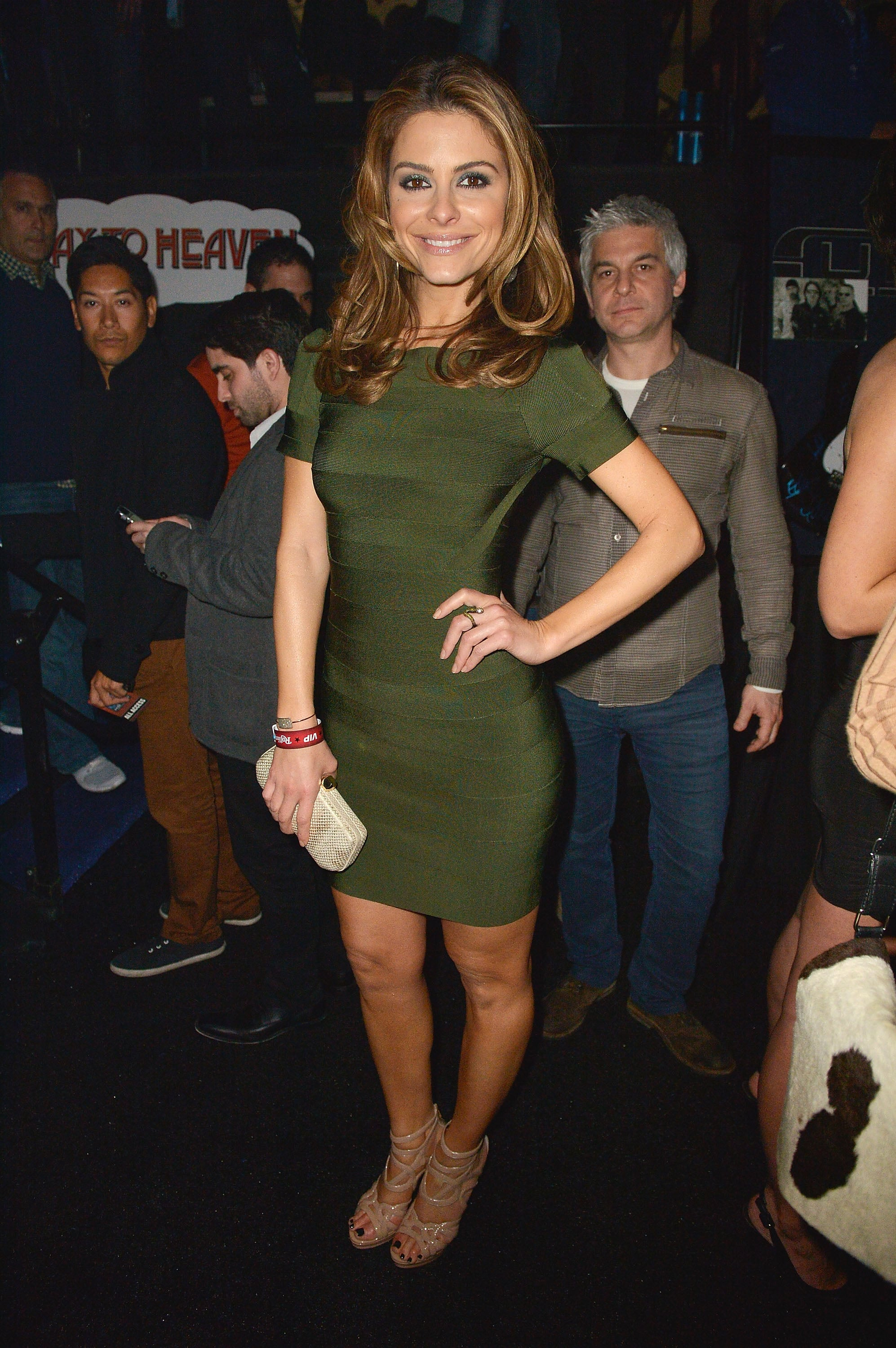 Maria Menounos wore a body-con olive green minidress, which she paired with nude strappy heels and a white textured clutch, at the Rolling Stone party.