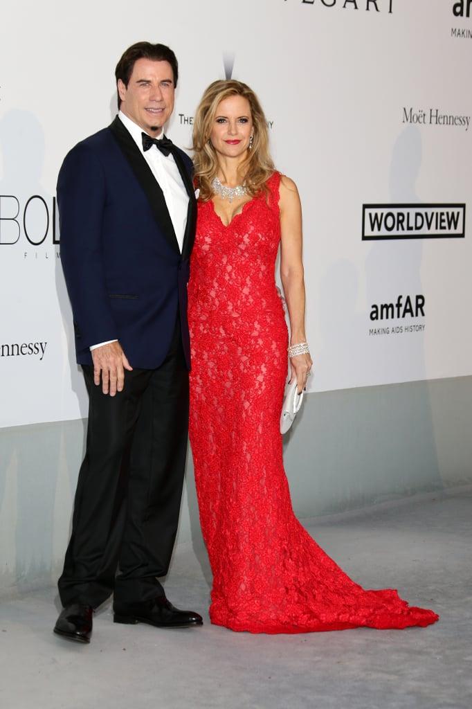 John Travolta and Kelly Preston posed for photos together at the amfAR Gala.
