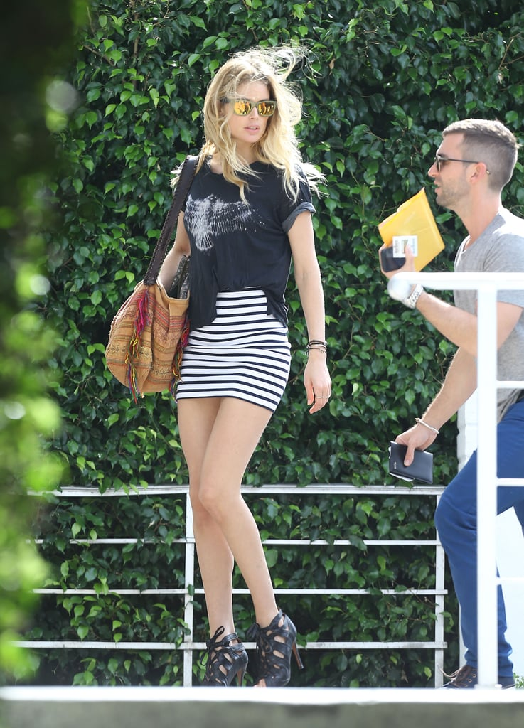 On or off the runway, a model knows: if you've got it, flaunt it. Doutzen Kroes picked a supersmall striped miniskirt and wore it with lace-up heels and a tee in Miami.