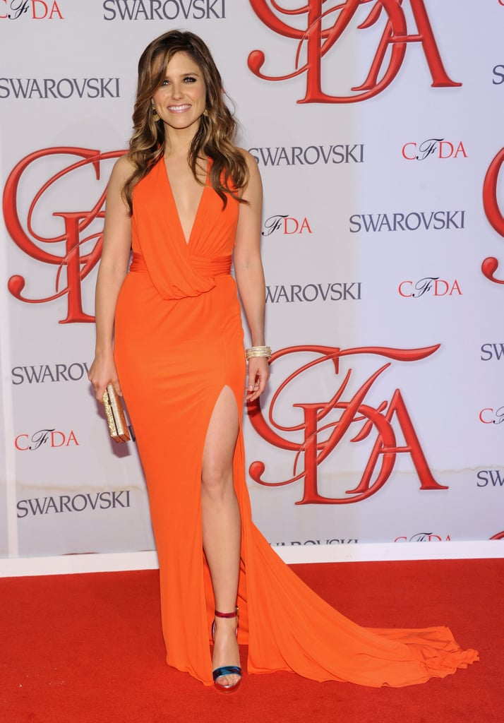 Sophia Bush made a sexy entrance in a low-cut David Meister gown with a thigh-high slit.