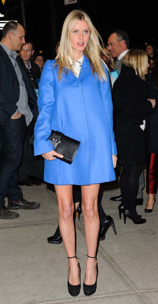 Nicky Hilton added a beautiful sky-blue coat to her look outside of the Girls premiere party in NYC.