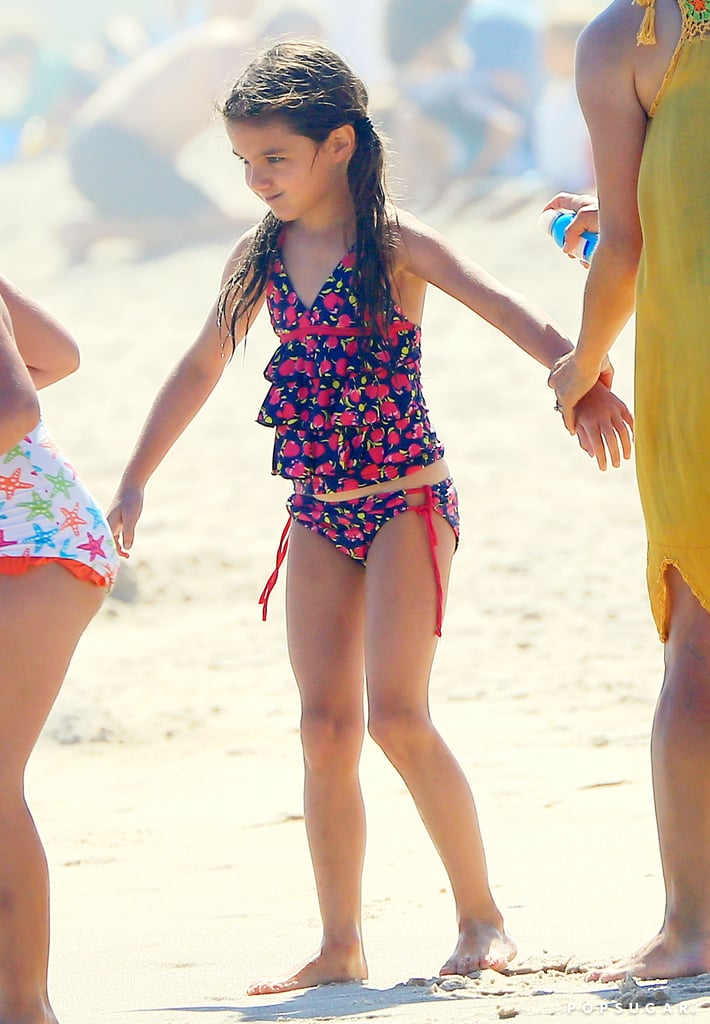 Suri Cruise played on the beach with her friends.