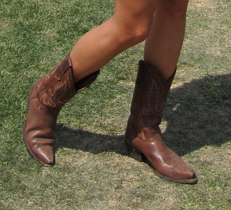 Cowboy boots are a festival standby — comfy and cute.