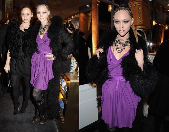 Model Sasha Pivarova Attends The Parisian Stella McCartney Store Opening in Purple Wrap Dress