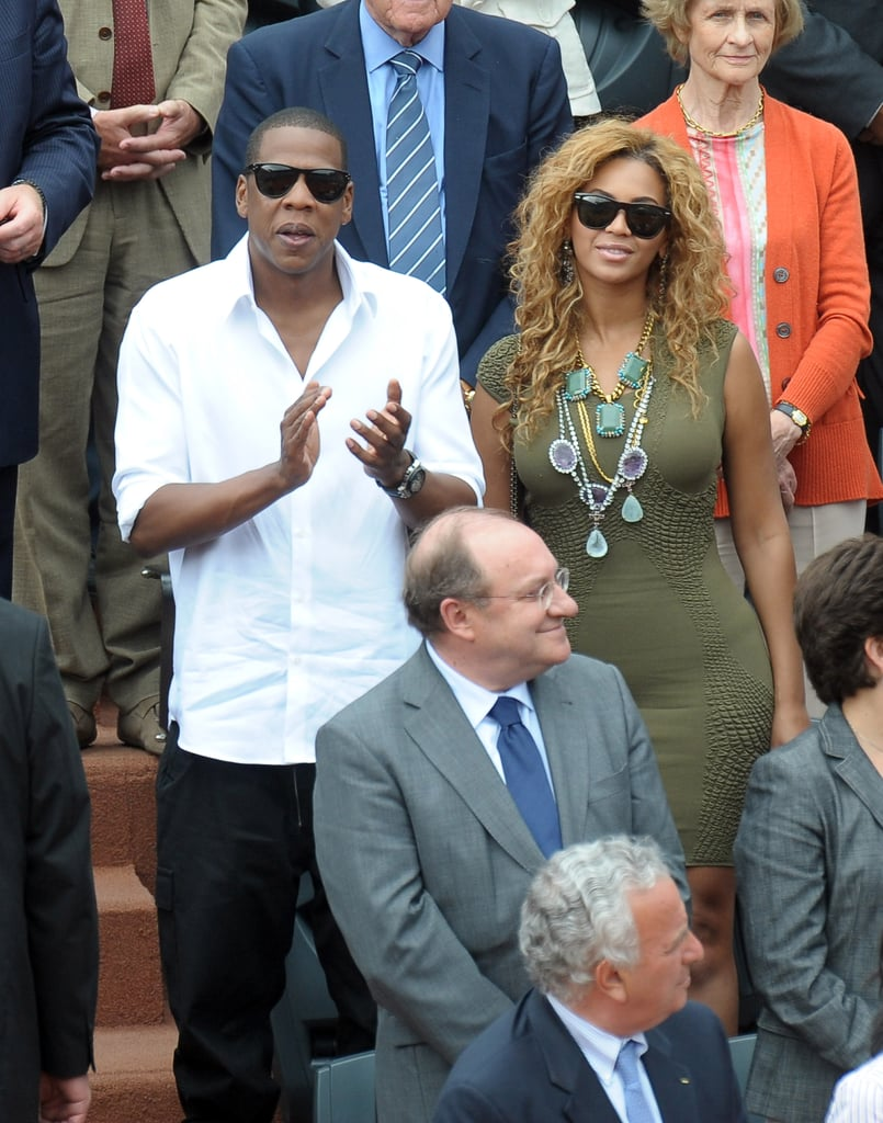 At the French Open in 2010, Jay Z wore a crisp white collared shirt while Beyoncé dressed up an olive-green dress with a statement necklace.