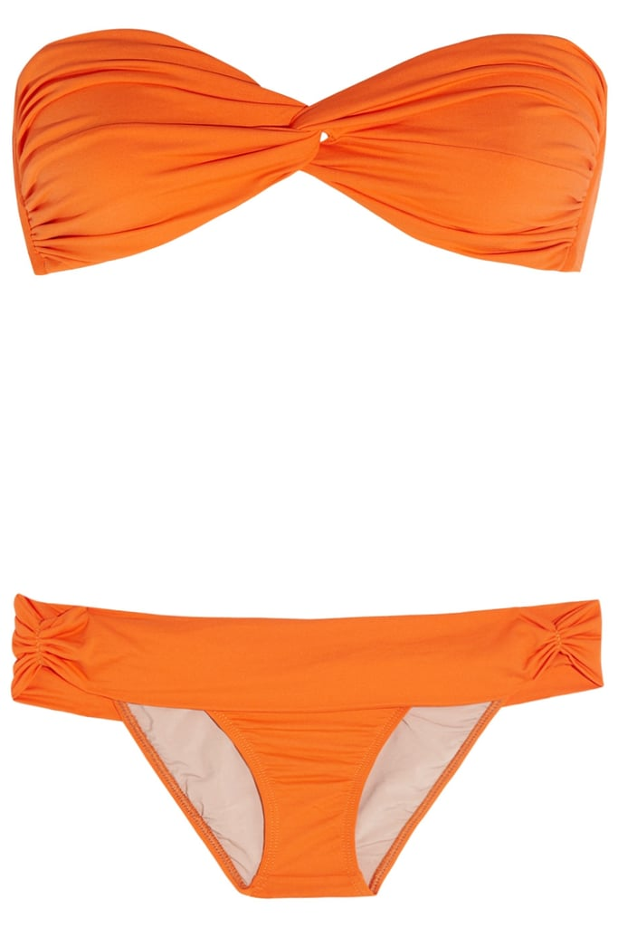The ultimate in curve-hugging silhouettes, this bright orange bikini would look amazing under a sheer white dress.  Tara Matthews Ruched Bandeau Bikini ($240)