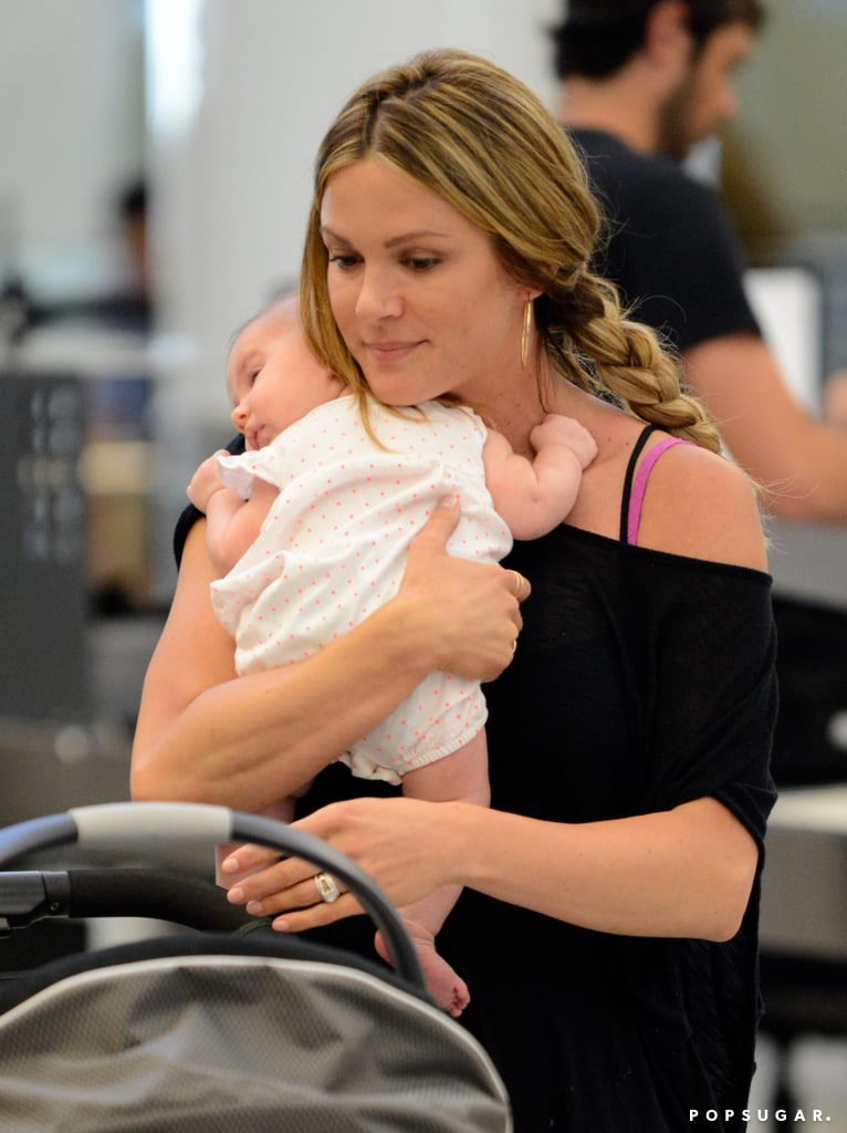Danneel Harris held her daughter, Justice Jay Ackles, while at LAX on Wednesday.