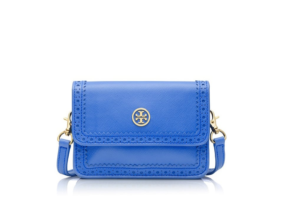 Done in a dark shade, the sweet scallop and perforated details on Tory Burch's crossbody bag ($250) would barely be visible. Show them off with a color that trends to the lighter side of the spectrum.