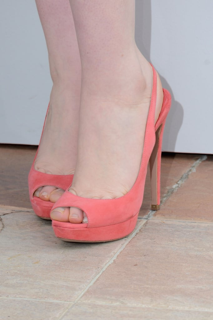 Mia's peachy peep-toes add a bright finishing touch to her look.
