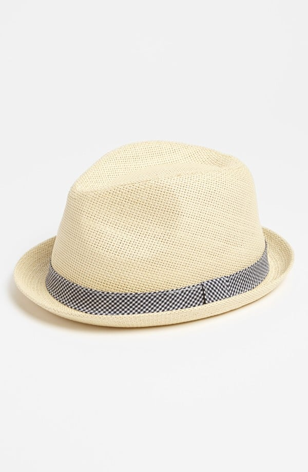 This light straw hat ($24) with an understated gingham ribbon fits kids ages 7-12.