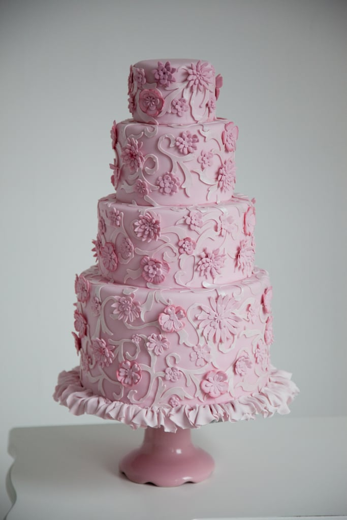 This cake, full of flowers, frills, and delicate details, has all the makings of a traditional cake — except it's all pink and was modeled after a Chanel dress.