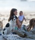 Gisele Bündchen relaxed on the beach with Vivian and their dogs.