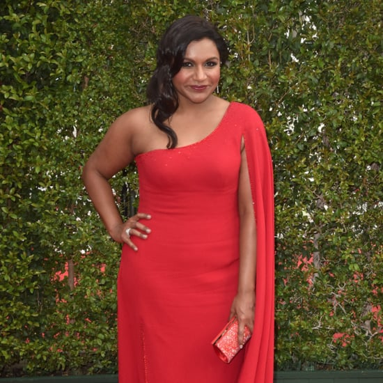 Mindy Kaling Wearing a Red Cape Dress