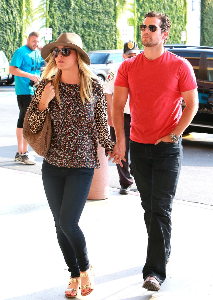 Henry Cavill and Kaley Cuoco held hands.