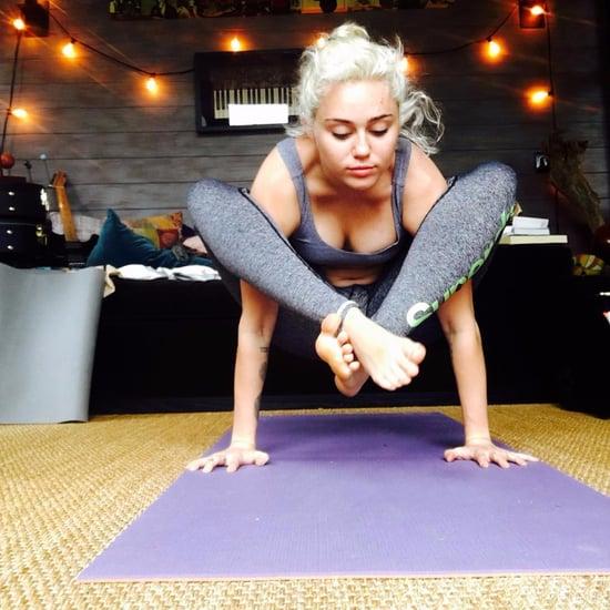 Miley Cyrus Instagram of Shoulder Press Yoga Pose