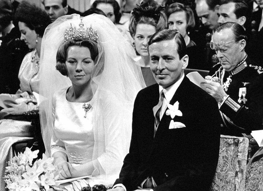 Queen Beatrix and Claus van Amsberg The Bride: Queen Beatrix of the Netherlands, then the crown princess. The Groom: Claus van Amsberg, a German aristocrat and diplomat. When: March 10, 1966. There were protests, including a smoke bomb thrown at the wedding caravan in Amsterdam on their wedding day, since Claus had served with the Hitler Youth. Where: Amsterdam.