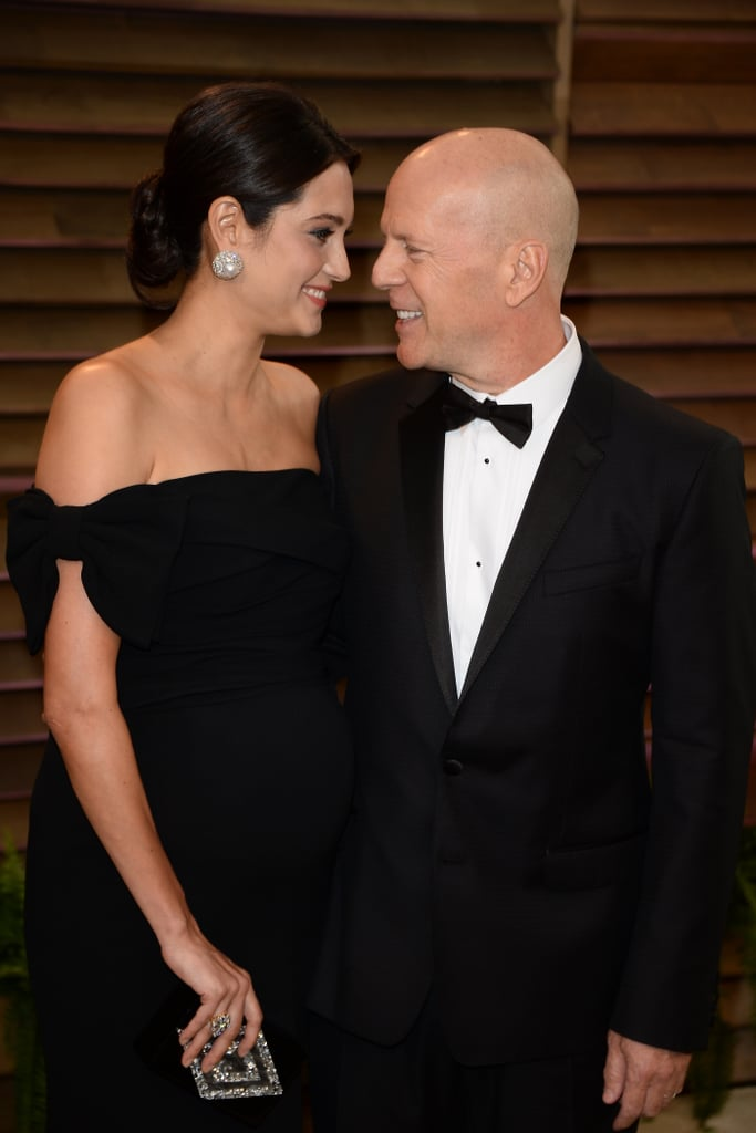Bruce Willis and Emma Heming-Willis shared the look of love at the Vanity Fair Oscars party.