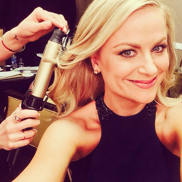 Golden Globes cohost Amy Poehler snuck in a selfie while getting her hair styled. Source: Instagram user stellamccartney