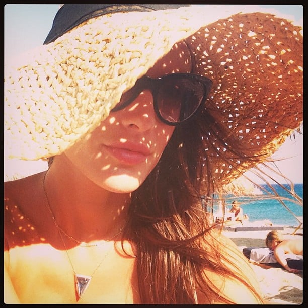 Alessandra Ambrosio protected her face from the sun with a giant straw hat. Source: Instagram user alessandraambrosio