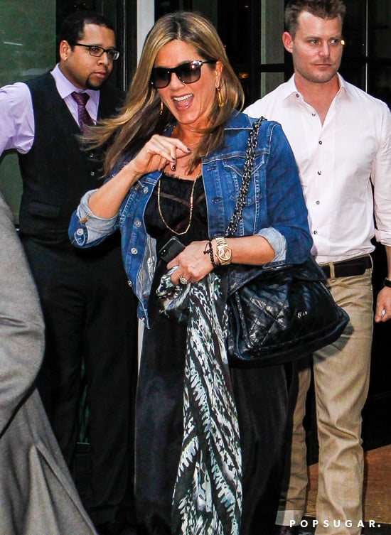 Jennifer Aniston gave a wave as she left a press day for We're the Millers in NYC.