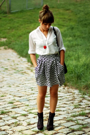 You can add sweet details, like a girlie, red heart-shaped pendant necklace, to your two-toned attire. Photo courtesy of Lookbook.nu