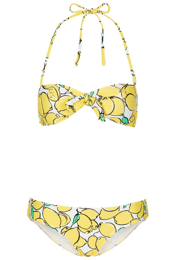 """Just looking at this Topshop yellow lemon bandeau bikini ($64) makes me happy, so it will be coming with me on all my upcoming pool and beach getaways. I also love that it features a subtly retro feel that will go great with my favorite cat-eye sunglasses."""" — Melody Nazarian"""
