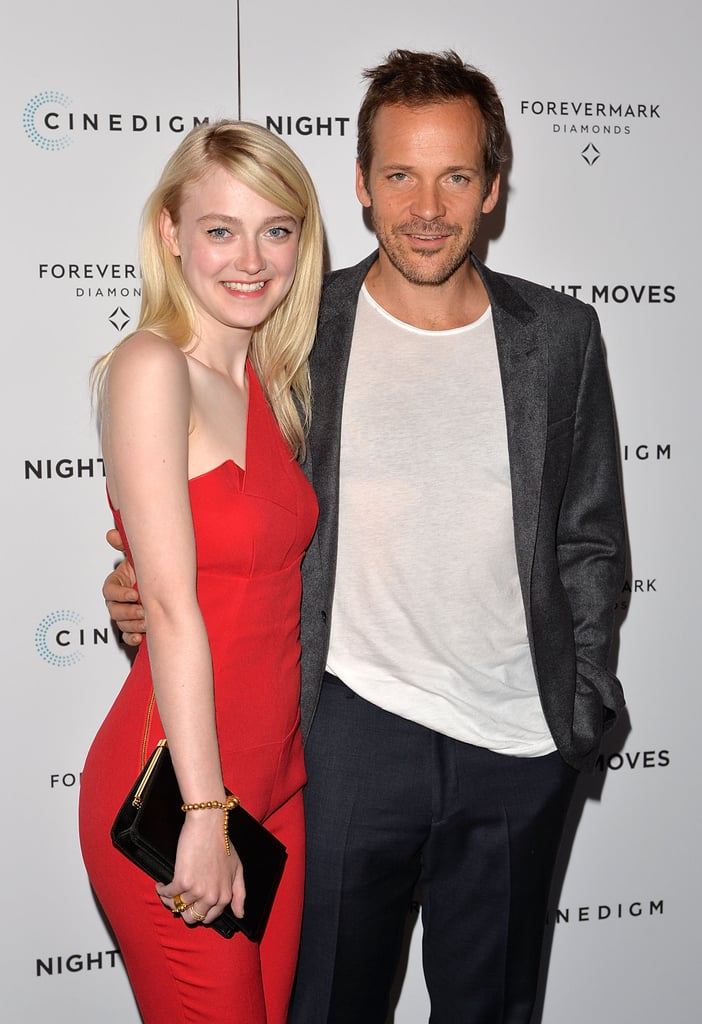 Dakota Fanning rocked a red jumpsuit at the Night Moves premiere in NYC on Tuesday alongside costar Peter Sarsgaard.