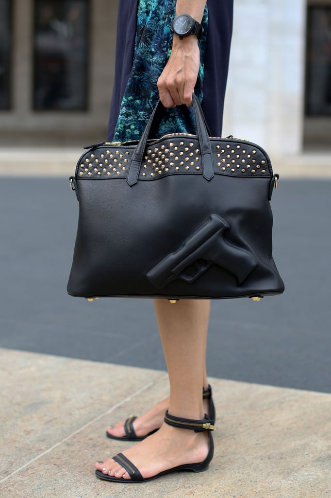A studded satchel and sandals with a hint of gold added just enough interest.