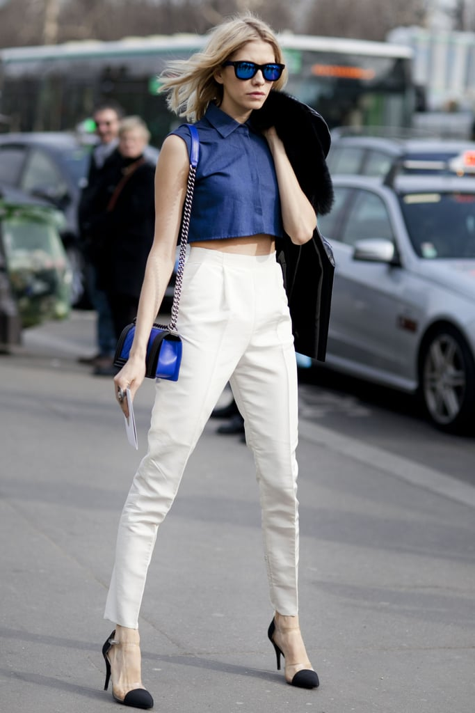 This is coordinated: from the metallic sunglasses to the blue top and bright satchel.