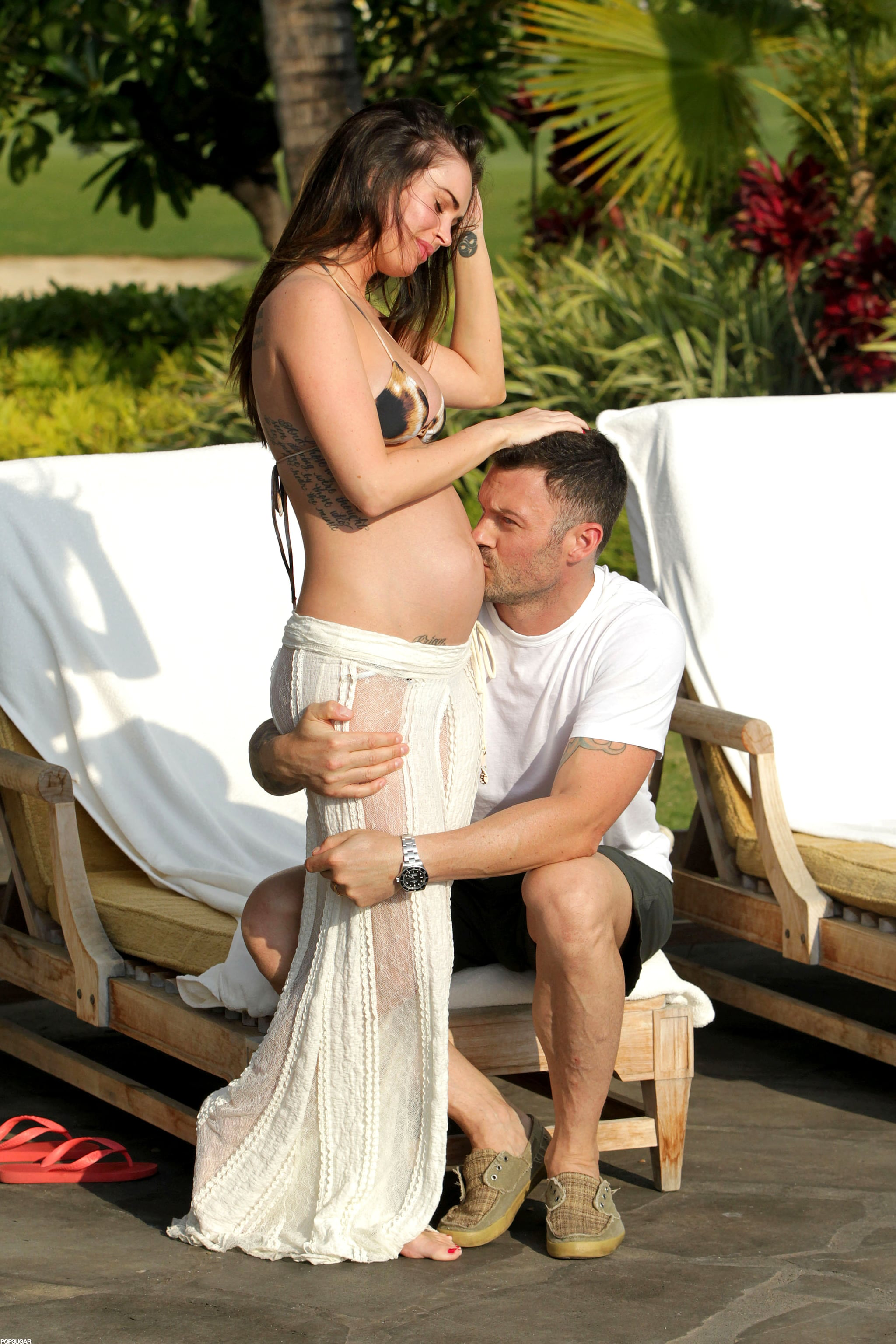 Brian kissed Megan's pregnant stomach during a vacation in Hawaii back in June 2012.