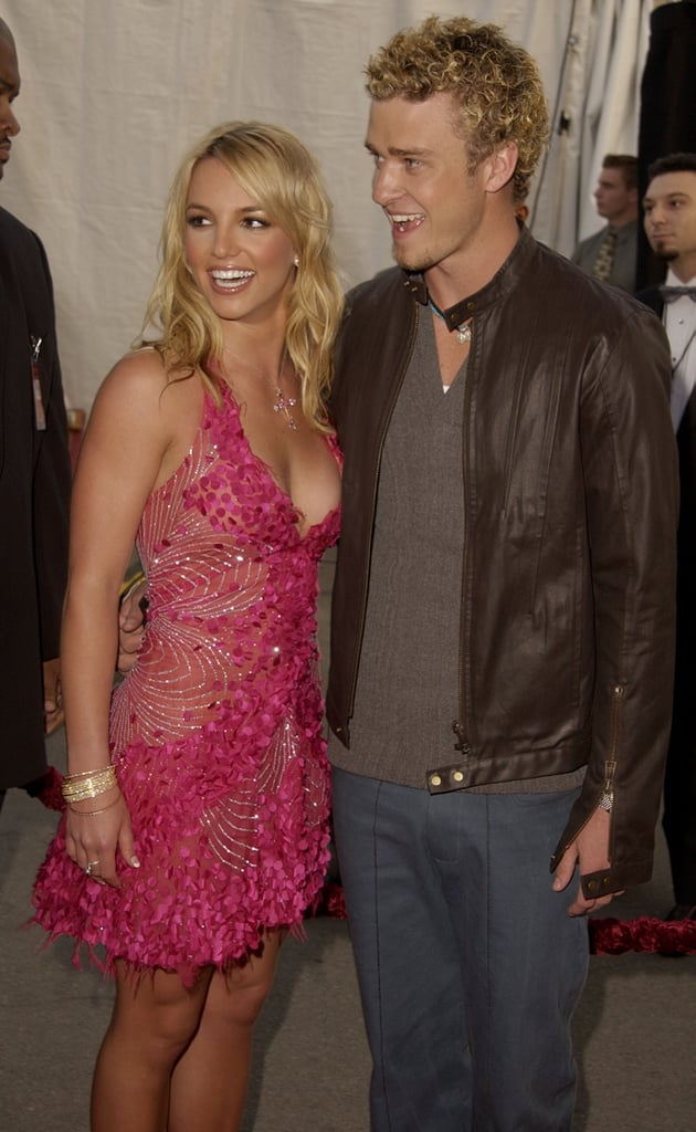 Britney Spears and then-beau Justin Timberlake posed backstage in 2002.