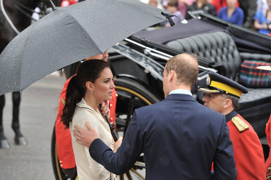 Prince William lovingly put a hand on Kate Middleton's shoulder.