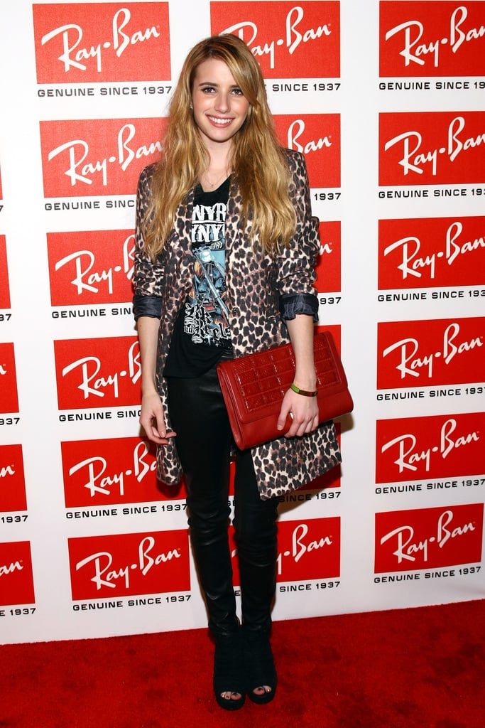 At a Ray-Ban bash in NYC in October 2011, Emma showed off her wild side in a rock tee, leopard coat, and oversized red Jimmy Choo clutch. To summon your edgy self, wear a similar band tee, leopard coat or blazer, and a bright red bag.       Coats by Chico'sBoots by Pour La Victoire