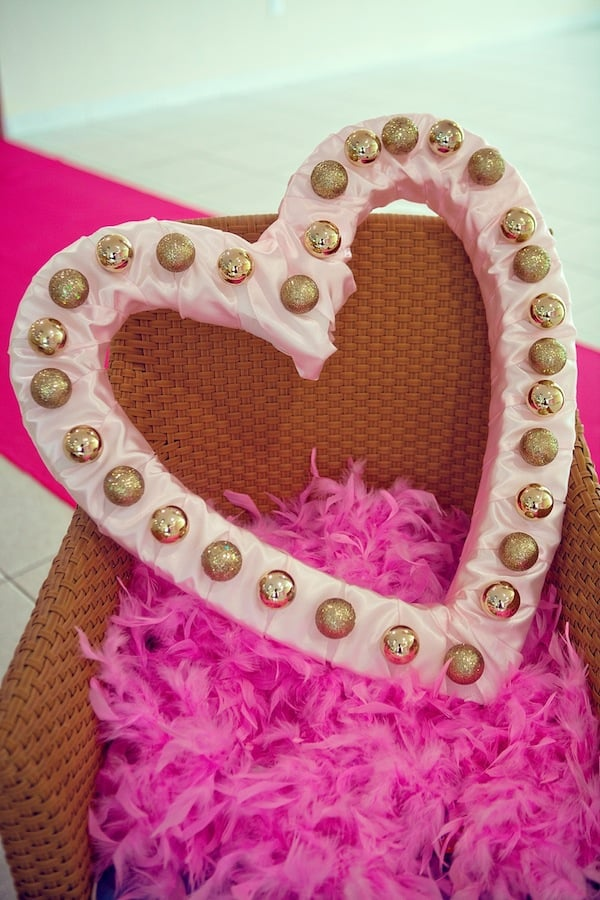 Use this heart-shaped marquee DIY to make your own cute photo booth prop.