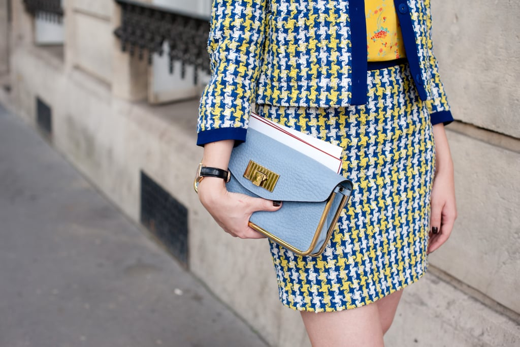 This season's handheld clutch made the perfect companion against a polished, printed suit.