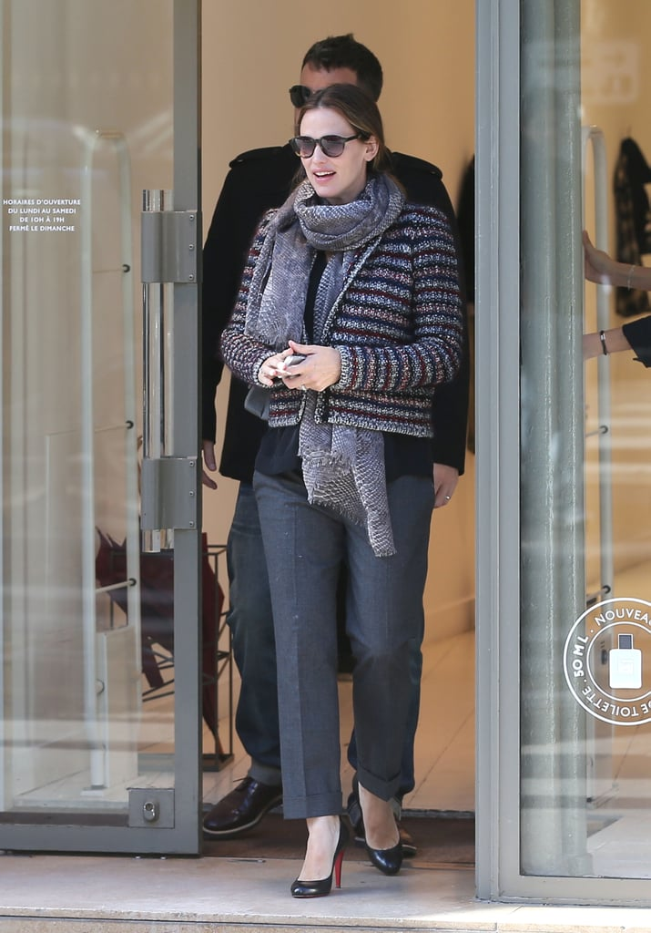 On her getaway in Paris, Jennifer Garner bundled up in a cozy Isabel Marant knit cardigan, a printed scarf, and gray cropped trousers.