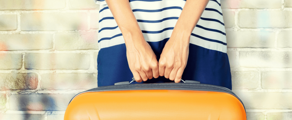 1 Woman Fit 25 Pieces of Clothing in a Tiny Suitcase With This Insane Trick