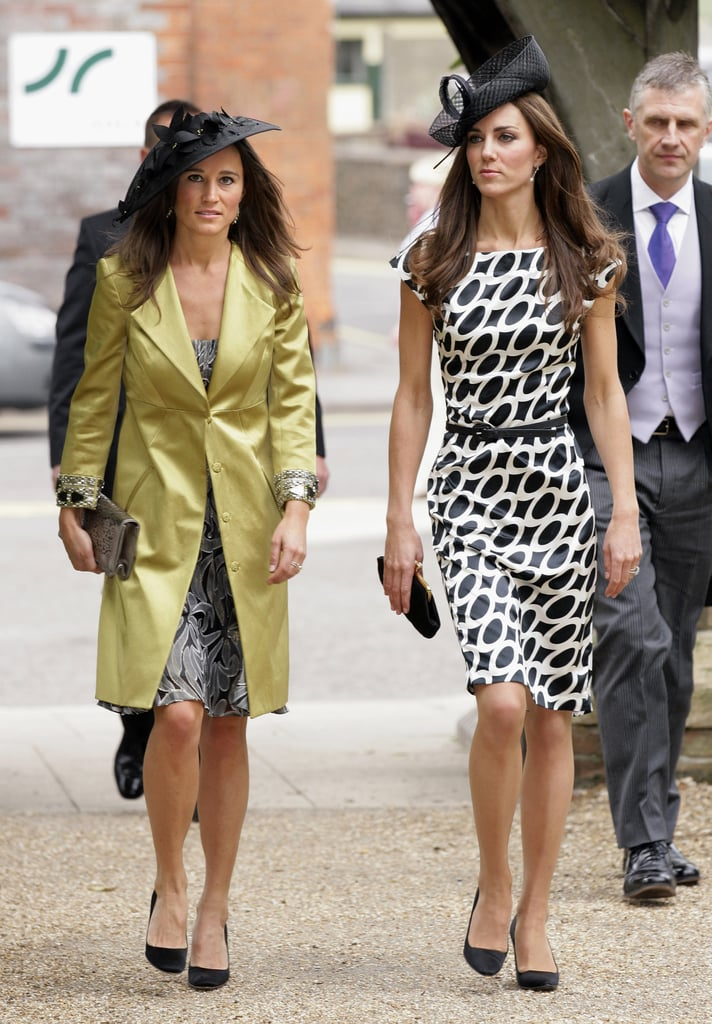 Sisters Kate and Pippa Middleton attended a friend's wedding in equally stylish black hats in June 2011.