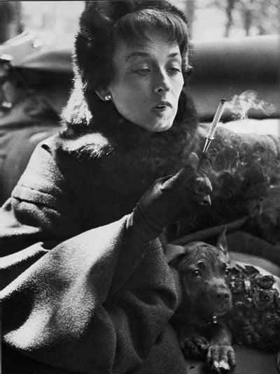 Dorian Leigh, Dior coat, photograph by Richard Avedon, Paris, 1949.