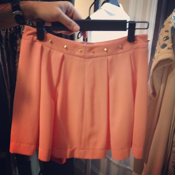 Gold studs add a subtle edge to these peachy shorts.