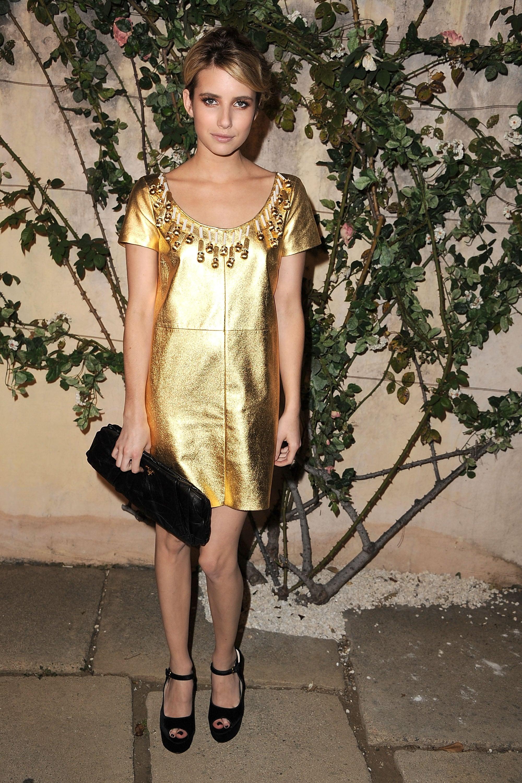 Emma stunned in a gold Miu Miu sheath for an event in July 2011.