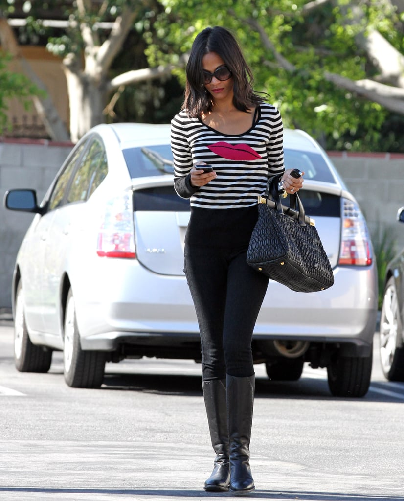 Zoe worked a striped tee and black riding boots while running errands in LA in 2010.