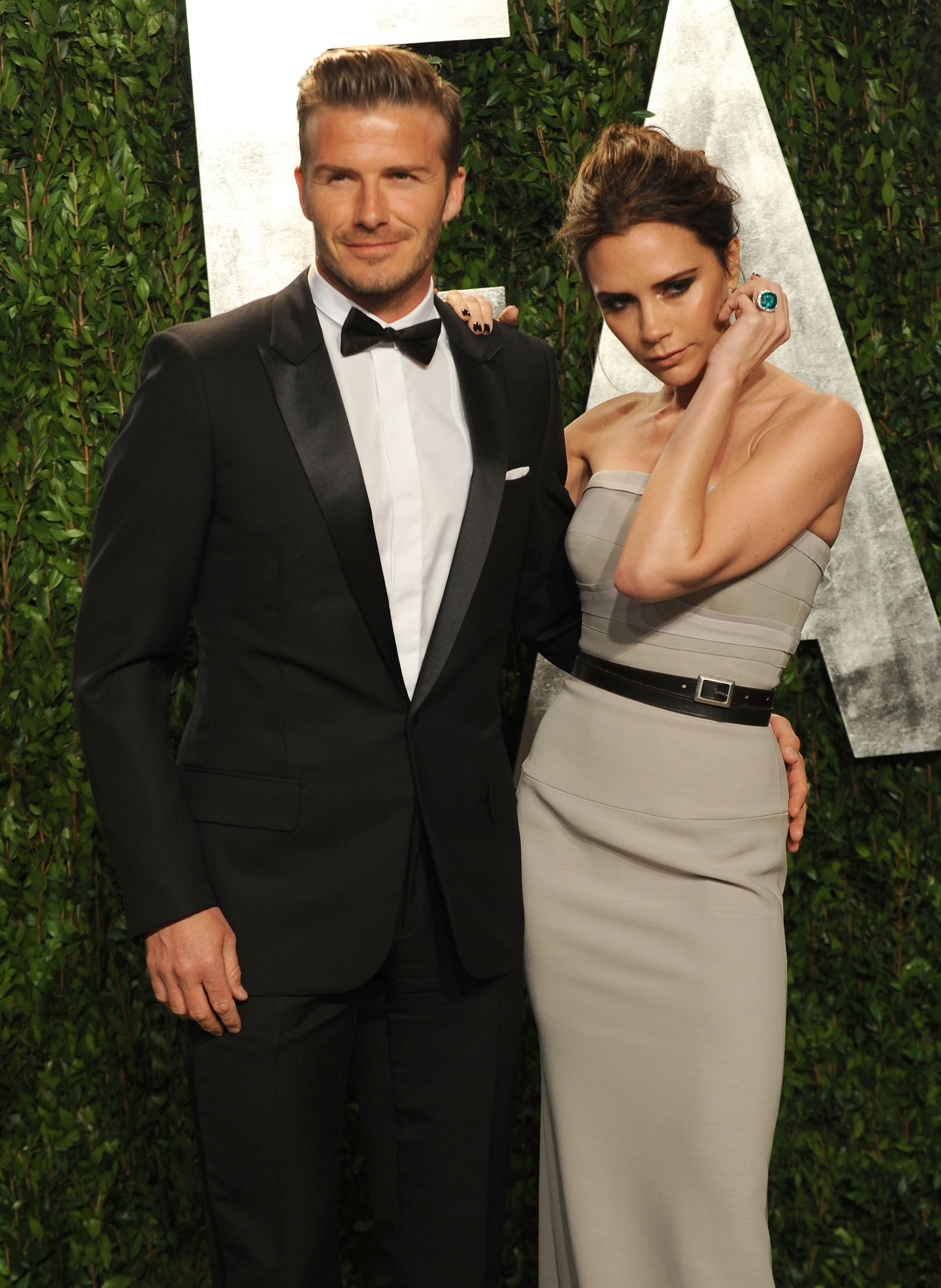 Victoria posed on David's arm at the February 2012 Vanity Fair Oscars party in LA.