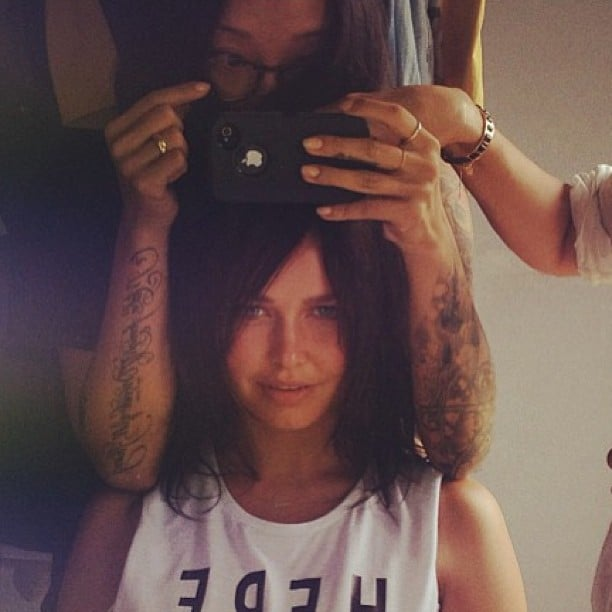 Lara Bingle goes brunette! At least, with someone else's hair. . . Jenny Kim lent some of her dark locks to the normally-blonde model.