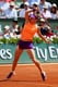 Simona Halep of Romania proved that orange and purple can be complementary colors at the French Open in 2014.
