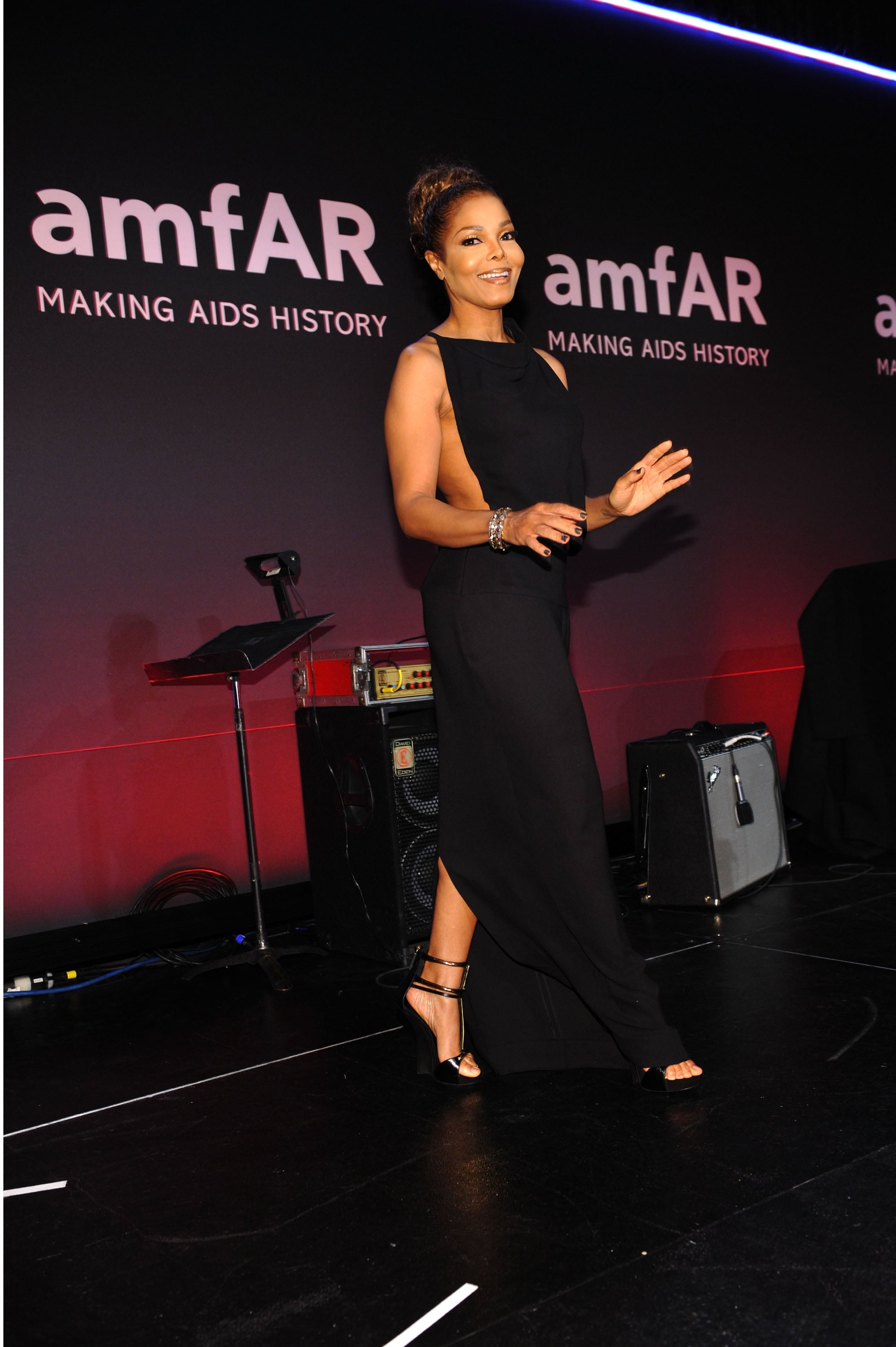 Janet Jackson, an amfAR honoree, took the stage in a sexy black gown with cutouts.